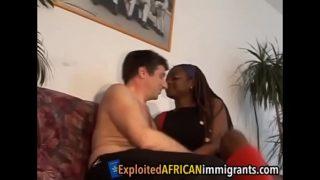 Ebony babe rides a white guy