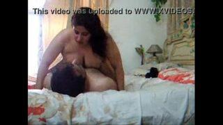 husbund & wife playng in bed